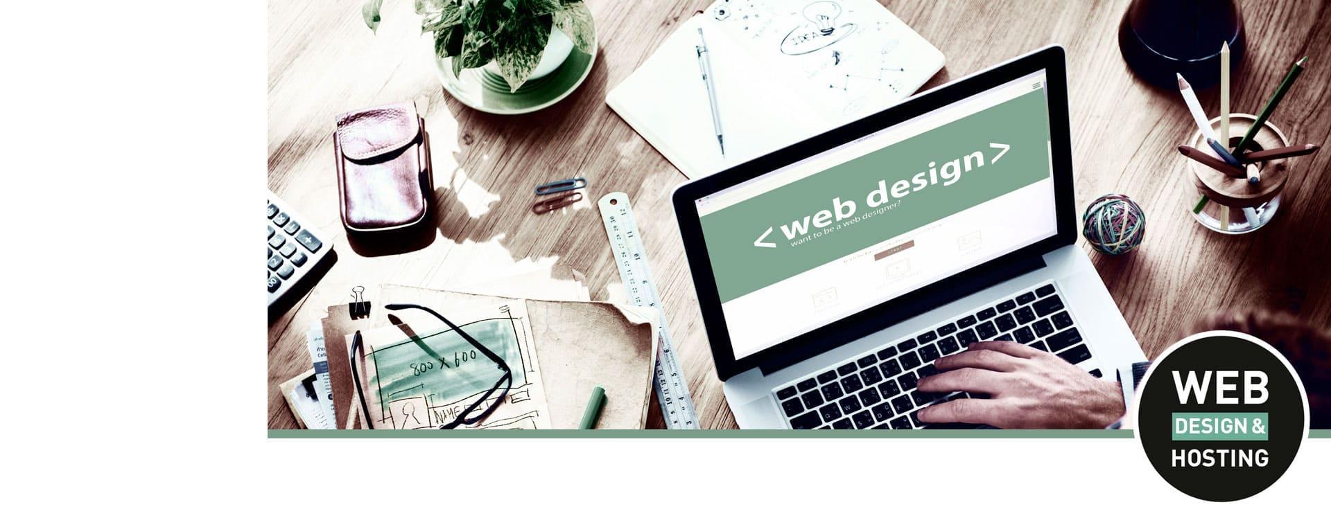 Notebook mit Motiv Design auf Schreibtisch Webdesign Rinteln